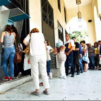 People line up at ATMs in Greece to get some cash out of their banks